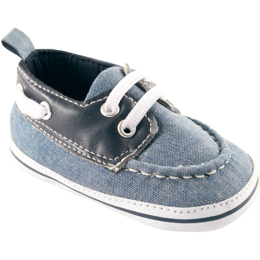 This listing is for a pair of baby boys GYMBOREE navy blue canvas boat shoes in size 2. They are crib shoes, so they are soft and lightweight.
