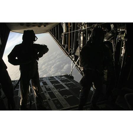 Pararescuemen prepare for a HALO jump aboard an HC-130 over Djibouti Canvas Art - Stocktrek Images (34 x 23)