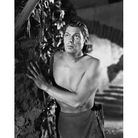 - Johnny Weissmuller Hiding Behind a Rock Wall in a Portrait Photo Print