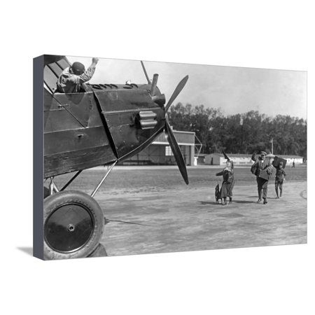 Family Rushing to a Prop Airliner, Ca. 1920s Stretched Canvas Print Wall Art By Scherl Süddeutsche Zeitung - 1920s Props