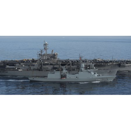 LAMINATED POSTER The fast combat support ship USNS Supply (T-AOE 6) resupplies the Danish navy frigate HDMS Peter Wil Poster Print 24 x 36