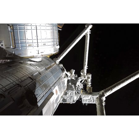 The Robotic Arm Of The Japanese Experiment Module Assists In Installing Components On The Japanese Exposed Facility Canvas Art   Stocktrek Images  34 X 23