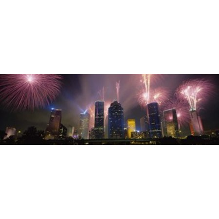 Fireworks Over Buildings In A City Houston Texas USA Canvas Art - Panoramic Images (18 x