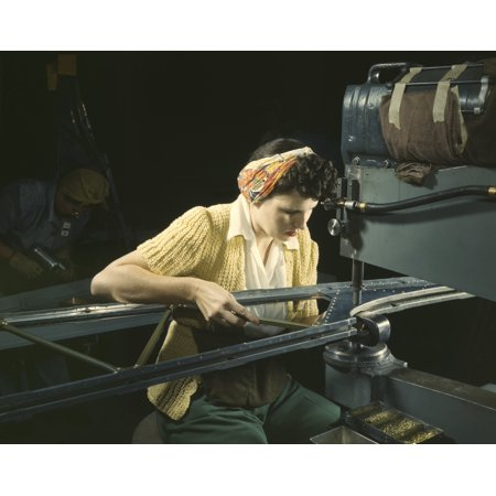 A woman riveting machine operator at an aircraft assembly plant during WWII 1942 Poster Print by Stocktrek Images