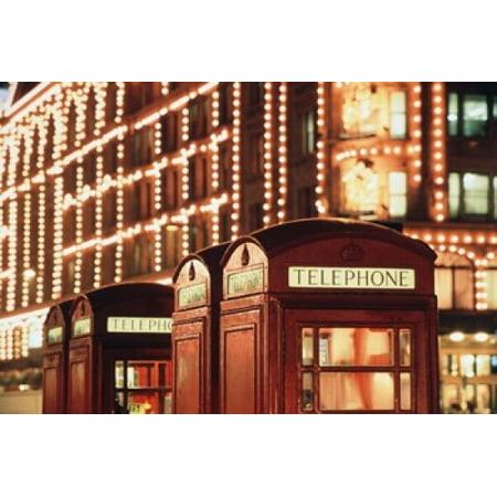 Lit Telephone booth at Harrods Knightsbridge London England Canvas Art - Walter Bibikow DanitaDelimont (35 x 23)