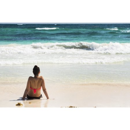 Young Woman Sitting On Sandy Beach In Water Looking Out At Waves Coming In And Blue Sky Akumal Quintana Roo Mexico Posterprint