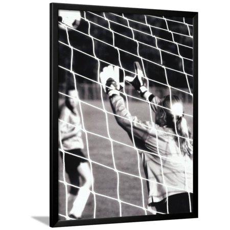 Female Goalie Attempting to Stop a Soccer Ball Framed Print Wall Art