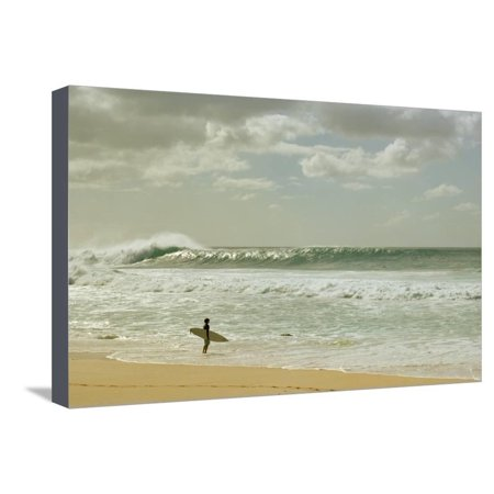 Surfer standing on the beach, North Shore, Oahu, Hawaii, USA Stretched Canvas Print Wall Art By Panoramic