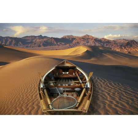 Drift Boat Resting On Sand Dunes In Death Valley National Park Representing Global Warming Digital Composite Posterprint