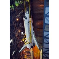 LAMINATED POSTER Space Shuttle Discovery is being raised to a vertical position and lifted into high bay 3 where it w Poster Print 24 x 36