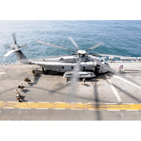 US Marines board an MH-53E Sea Dragon helicopter aboard the USS Peleliu Poster Print by Stocktrek Images