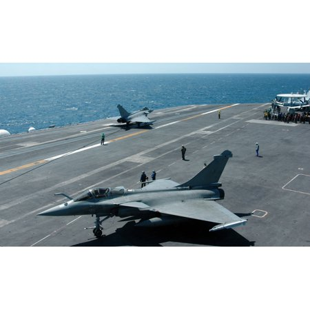 LAMINATED POSTER Two French Rafale Jets perform launch and recovery operations from the flight deck of the aircraft c Poster Print 24 x (Jet 2 Flights)