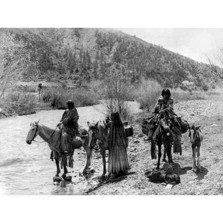 Apache Group C1906 Ngroup Of Apache Men And Women One With A Child With Horses Laden With Water Jugs Near A Stream Photograph By Edward Curtis C1906 Rolled Canvas Art     24 X 36