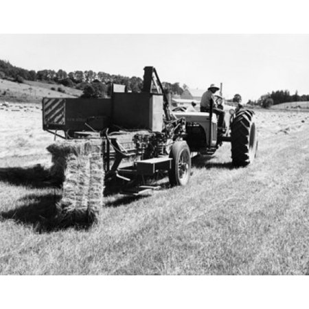 Farmer sitting on a tractor pulling hay baler in a field Canvas Art - (24 x 36)
