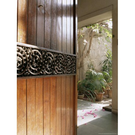A Modern Front Door Decorated with a 400 Year Old Piece of Wood Carving Print Wall Art By John Henry Claude Wilson ()