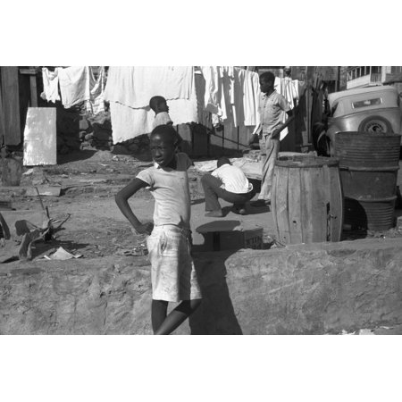 St Thomas Slum 1941 Nchildren In One Of The Slum Areas In St Thomas Charlotte Amalie The Capital Of The Us Virgin Islands Photographed By Jack Delano In December 1941 Rolled Canvas Art     24 X 36