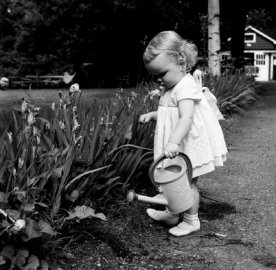 Girl watering flowers Canvas Art -  (24 x 36)