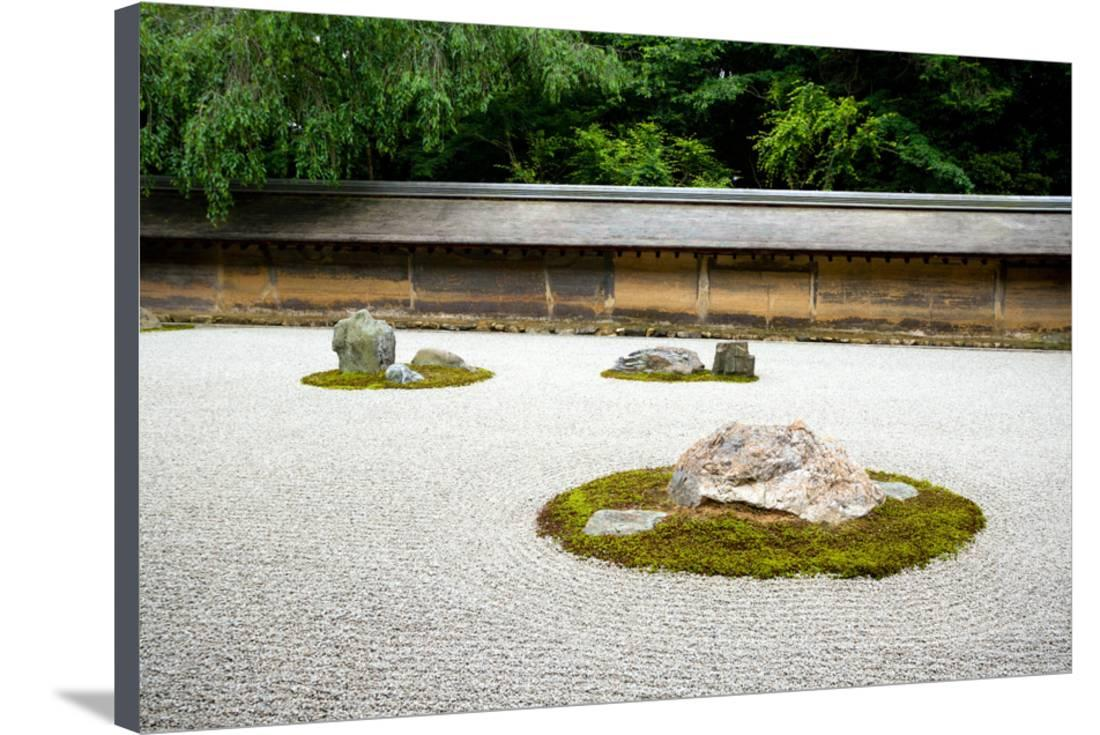 A Zen Rock Garden In Ryoanji Temple.In A Garden Fifteen Stones On White  Gravel
