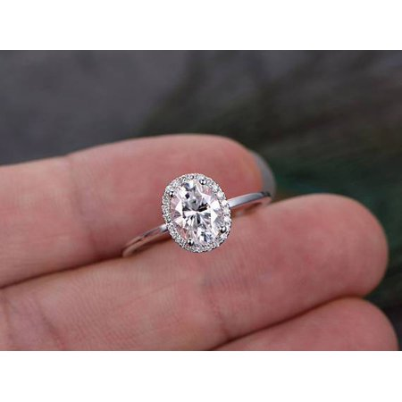 1.25 Carat oval cut Moissanite and Diamond Halo Engagement Ring in 18k White Gold Over Silver (Fake Oval Engagement Rings)