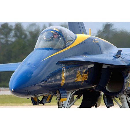 (Crew chief performs a pre-show engine run-up on one of the Blue Angels FA-18A Hornets Poster Print by Stocktrek Images)