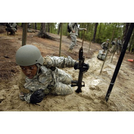 A US Army recruit negotiating the confidence course during basic combat training at Fort Jackson South Carolina
