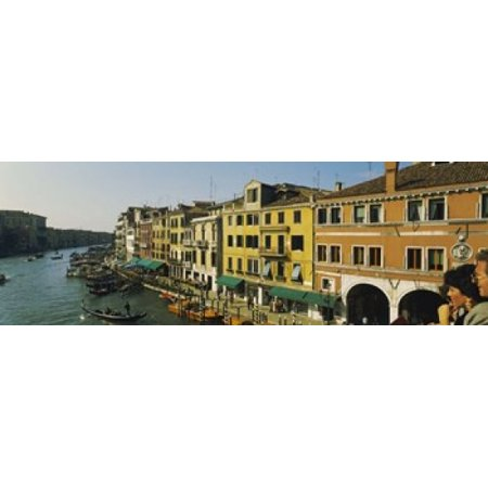 Tourists looking at gondolas in a canal Venice Italy Canvas Art - Panoramic Images (18 x 6) (Italian Gondola Driver)
