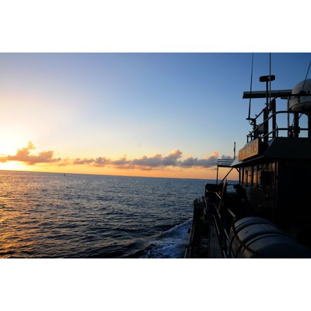 LAMINATED POSTER The sun falls over the U.S. Army Landing Craft Utility-New Orleans, off the coast of Key West, Feb. Poster Print 24 x 36