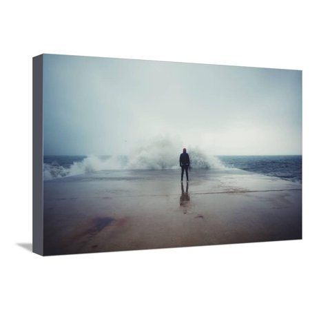 Standing Portrait - Back View Portrait of Young Man Standing against the Sea on a Large Concrete Pier with Big Wave Bea Stretched Canvas Print Wall Art By GaudiLab