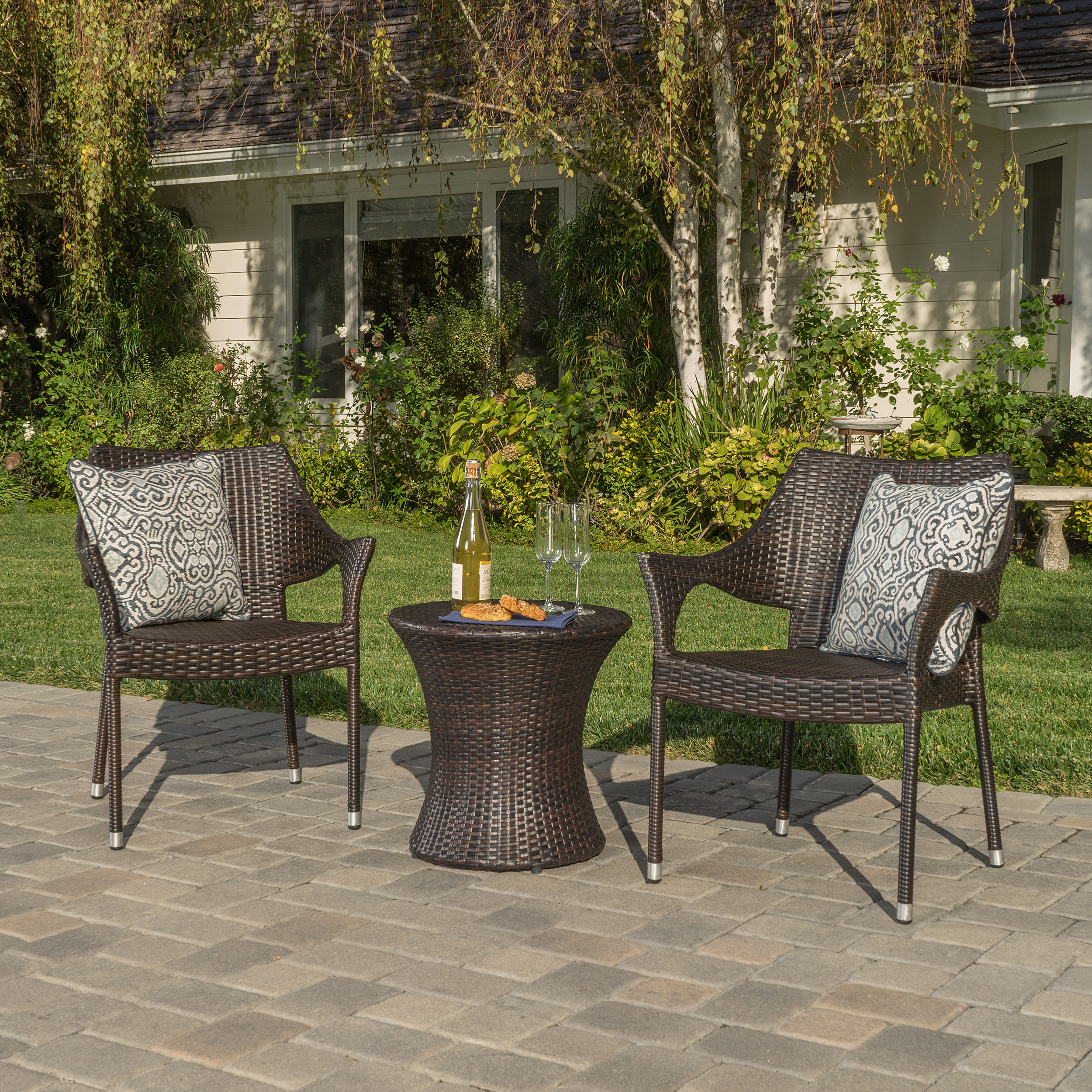 Tortuga Outdoor Brown Wicker 3 Piece Stacking Armchair and Table Set by GDF Studio