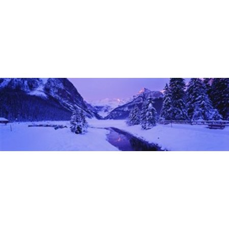 Lake in winter with mountains in the background Lake Louise Banff National Park Alberta Canada Poster Print