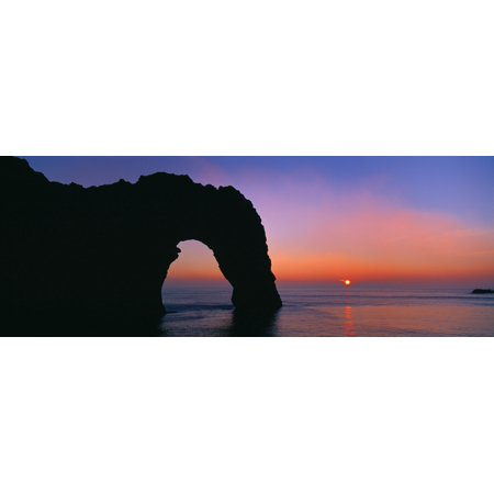 Silhouette of natural arch Durdle Door Dorset England Stretched Canvas - Panoramic Images (36 x (8 Deep Arch Door)