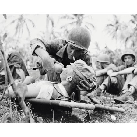 Navy corpsman gives drink to a wounded Marine in Guam 1944 Poster Print by Stocktrek Images - Ship To Guam
