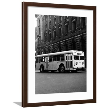 1930s-1940s Public Transportation Trackless Trolley Electric Bus About to Round Street Corner Framed Print Wall Art ()