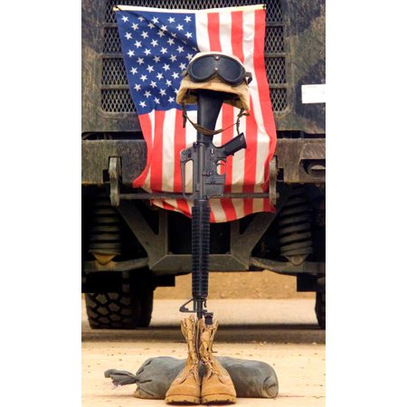 An M16-A2 service rifle a pair of boots and a helmet stand in tribute to a fallen soldier Poster Print by Stocktrek