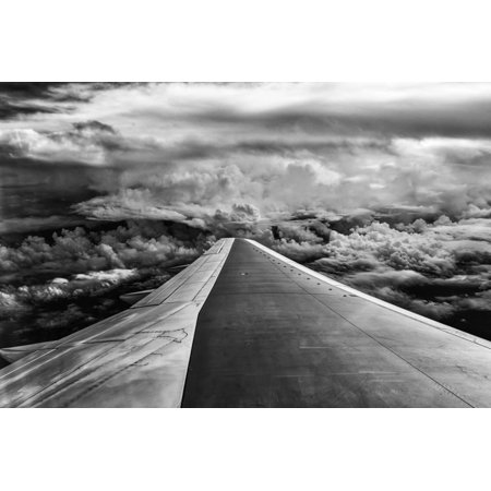 Wing of Airplane Flying in Mid-Air under and Between Clouds Print Wall Art By Liyun Yu 3 Piece Mid Wing
