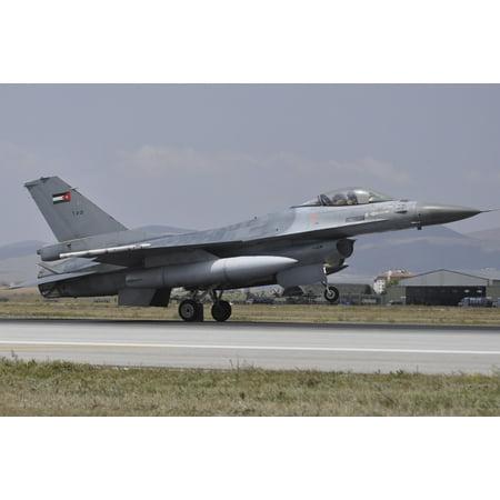 A Royal Jordanian Air Force F-16AM aircraft landing at Konya Air Base Turkey during Exercise Anatolian Eagle 2014 Poster Print