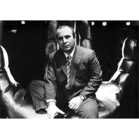 Bob Hoskins wearing a suit in a hand sculpture Photo Print
