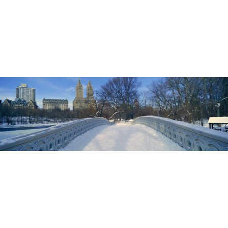 Panoramic view of bridge over frozen pond in Central Park Manhattan NY on upper west side near Central Park West Poster Print