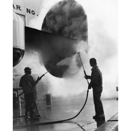 Steam Manual - Manual workers cleaning airplane with steam Stretched Canvas -  (24 x 36)