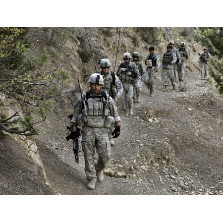 October 13 2009 - US Soldiers and Afghan Border Policemen walk along a mountain trail during a patrol near Combat Outpost Herrera in the Paktika province of Afghanistan Poster Print