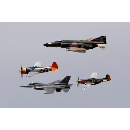 An F-4 Phantom P-47 Thunderbolt F-16 Fighting Falcon and P-51 Mustang fly in a heritage flight Poster Print by Stocktrek (F4 Poster)
