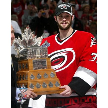 Cam Ward - holding the Conn Smythe Trophy - 2006 Stanley Cup Finals  Winner