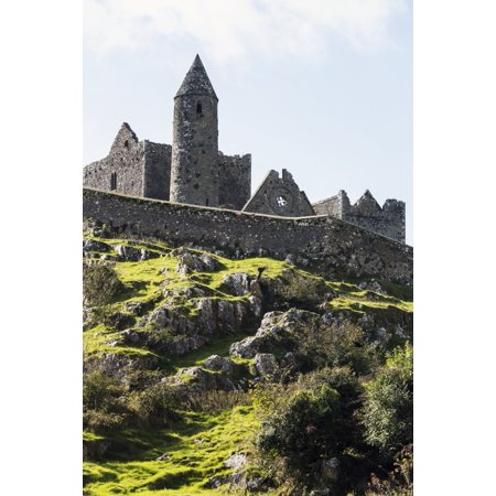 Ancient stone ruin with stone wall turret and church on rocky grassy hillside with blue sky and clouds Cashel County Tipperary Ireland Stretched Canvas - Michael Interisano  Design Pics (12 x (Best Rocket Stove Design)