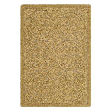 - Safavieh Cambridge Hand-Tufted Light Gold Area Rug