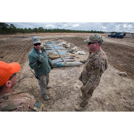 LAMINATED POSTER Master Sgt. Dustin Heines, center, 514th Air Mobility Wing Explosive Ordnance Disposal (EOD), Air Fo Poster Print 24 x (Mobility Center)