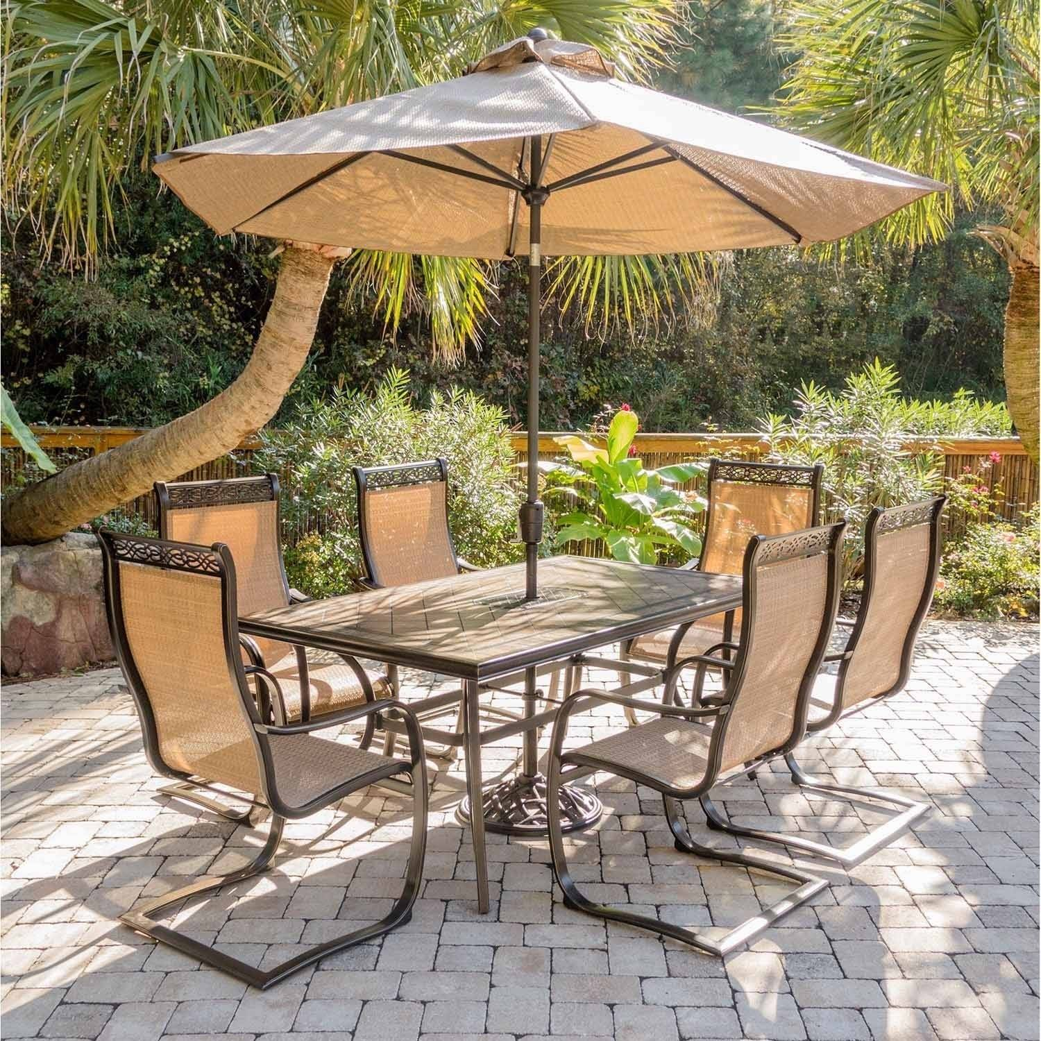 Hanover Outdoor Monaco 7-Piece Tile-Top Dining Set with Sling C-Spring Chairs and Umbrella w/Stand in Cedar