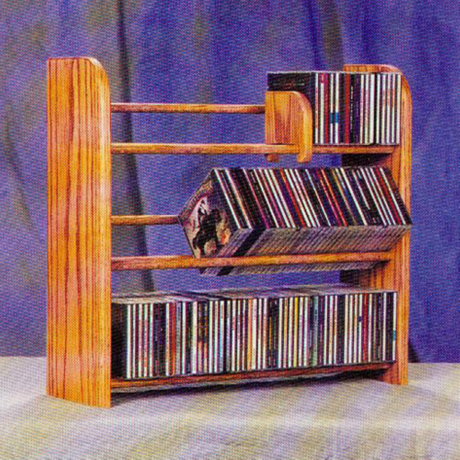 The Wood Shed Solid Oak 3 Row Dowel 165 CD Media Rack by The Wood Shed