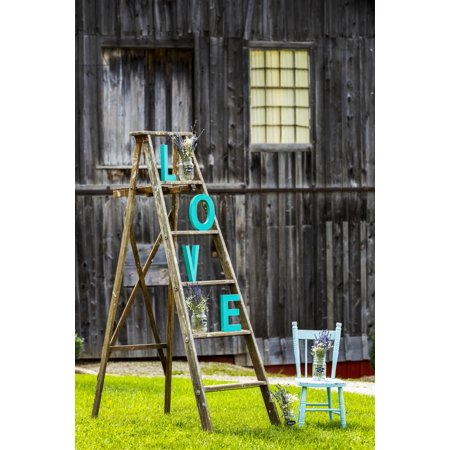 Wooden ladder on grassy lawn with L O V E letters placed on steps with old rustic wooden barn in the background and old wooden painted chair Walters Fall Ontario Canada Poster Print by Michael Interis