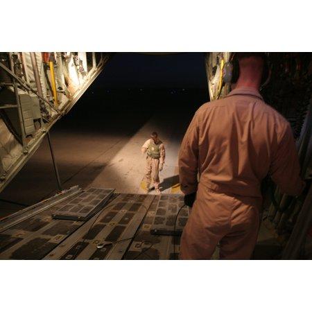 Canvas Print Corporal Matt Hunter controls the back entrance of a KC-130J as Sgt. Michael G. Torres mulls his opt Stretched Canvas 10 x 14