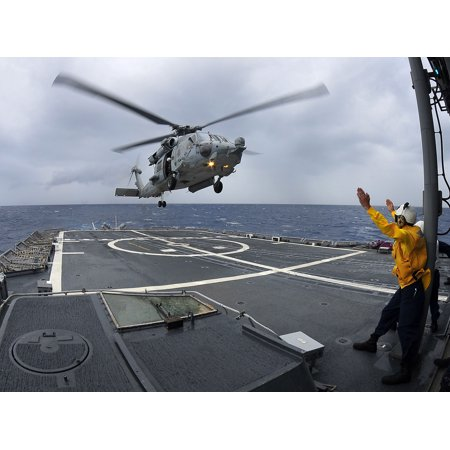 LAMINATED POSTER An SH-60F Sea Hawk helicopter assigned to the Red Lions of Helicopter Anti-submarine Squadron lands Poster Print 24 x 36